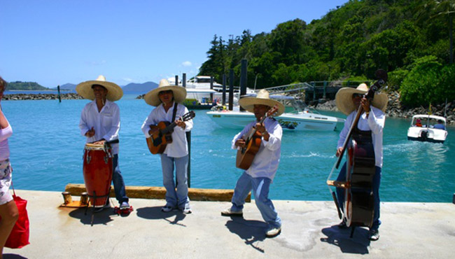 A tropical band welcomes us to the Whit Sunday Islands in Australia