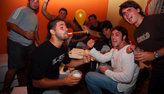 Revelers party on New Year's Eve at a hostel in Montivideo, Uruguay