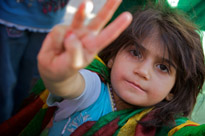 A girl is wrapped in the Kurdish flag in Bismil, Turkey.