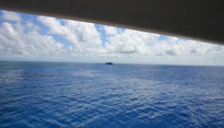 A ship is seen in the distance while diving in the Great Barrier Reef