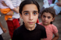 Kids pose for a photo in the street in Bismil, Turkey