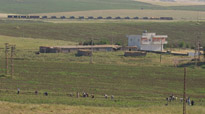 Tanks can be seen in the distance heading for the Turkey - Iraq border